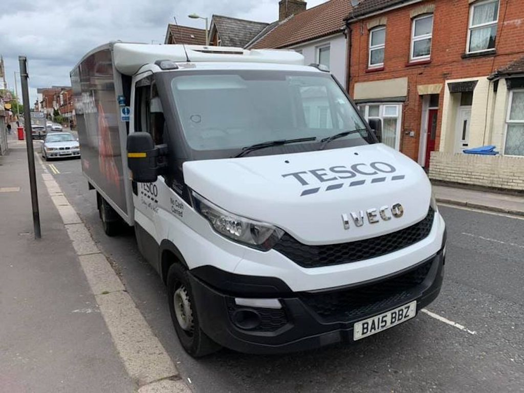 Delivery van parked by kerb